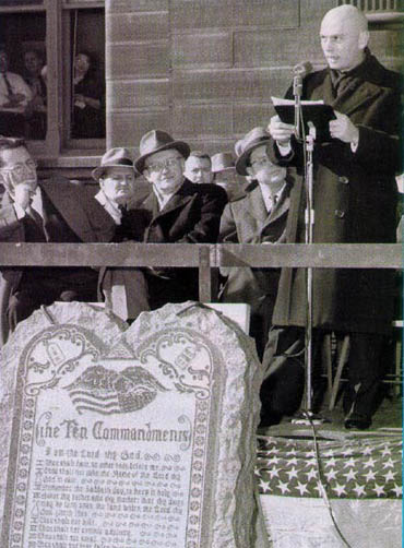 Yul Brynner (aka Pharoah) at  unveils Ten Commandments monument  at press conference with Cecil B. De Mille